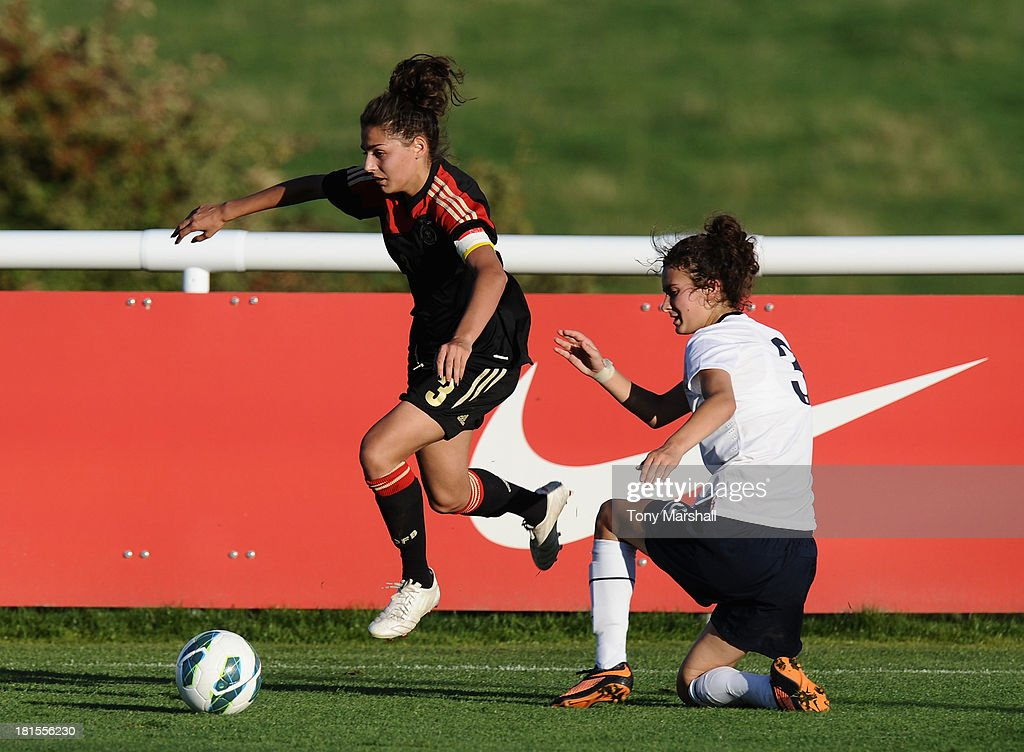 Rosella Ayane of England tackles Manjou Wilde of Germany during the Women's International Friendly match between England Under 19 Women and Germany Under 19 Women at St George's Park on September 22, 2013 in Burton upon Trent, England.