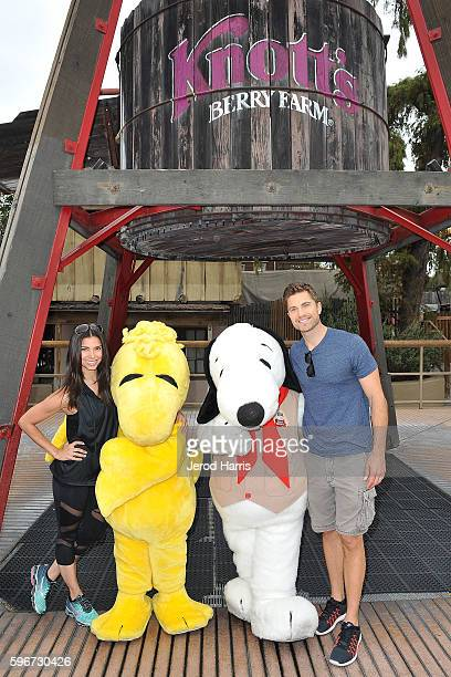 Roselyn Sanchez and Eric Winter visit Camp Snoopy at Knott's Berry Farm on August 27 2016 in Buena Park California