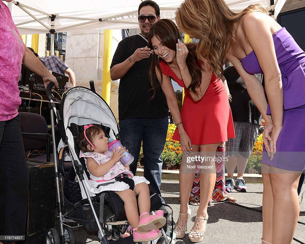 Roselyn Sanchez and her daughter Sebella Rose Winter visit 'Extra' at The Grove on July 17, 2013 in Los Angeles, California.