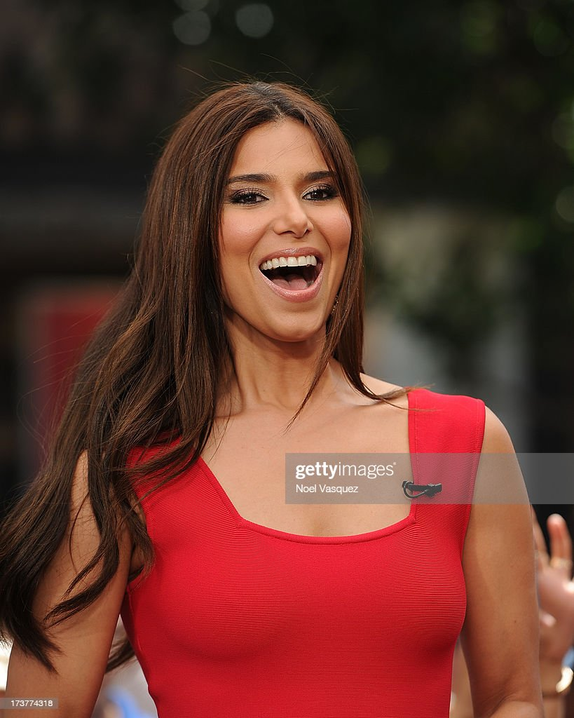 <a gi-track='captionPersonalityLinkClicked' href=/galleries/search?phrase=Roselyn+Sanchez&family=editorial&specificpeople=202260 ng-click='$event.stopPropagation()'>Roselyn Sanchez</a> visits 'Extra' at The Grove on July 17, 2013 in Los Angeles, California.