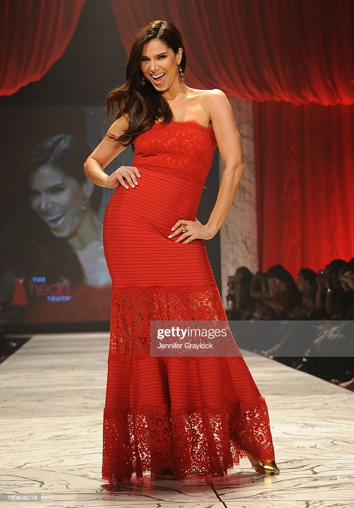Roselyn Sanchez wearing Tadashi Shoji on the runway during The Heart Truth 2013 Fashion Show held at the Hammerstein Ballroom on February 6, 2013 in New York City.