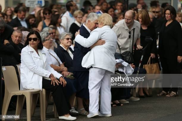 Roselyne the sister of French Father Jacques Hamel greets Sister Danielle who was one of the five people held hostage in the SaintEtienneduRouvray...