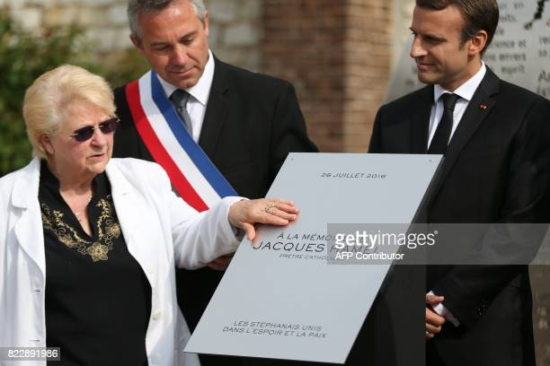 Roselyne the sister of French Father Jacques Hamel unveils a plaque in tribute to her brother next to SaintEtienneduRouvray's mayor Joachim Moyse and...