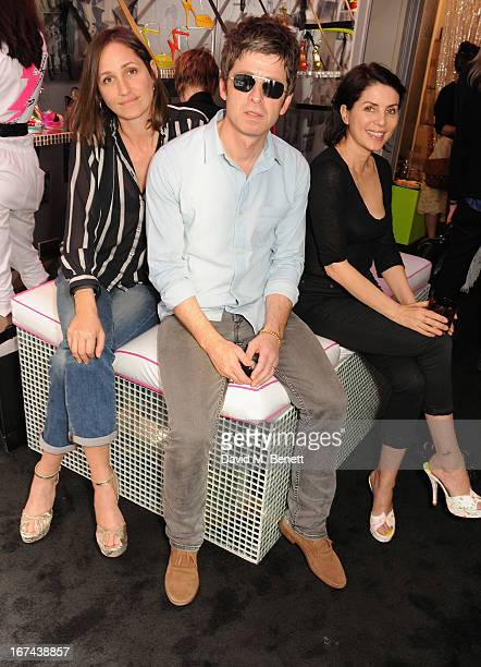 Rosemary Chapman Noel Gallagher and Sadie Frost attend the Terry de Havilland Store Opening at 8 Ganton Street on April 25 2013 in London England