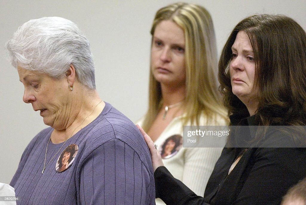 Rosemary Fries (L) mother of Green River Killer victim Shirley Sherrill speaks at the sentancing of Gary Ridgway as her daughters Deanna Brewer (C) and Michele Andrews listen in King County Washington Superior Court December18, 2003 in Seattle, Washington. Ridgway recieved 48 life sentences, with out the possibility of parole, for killing 48 women over the past 20 years in the Green River Killer serial murder case.