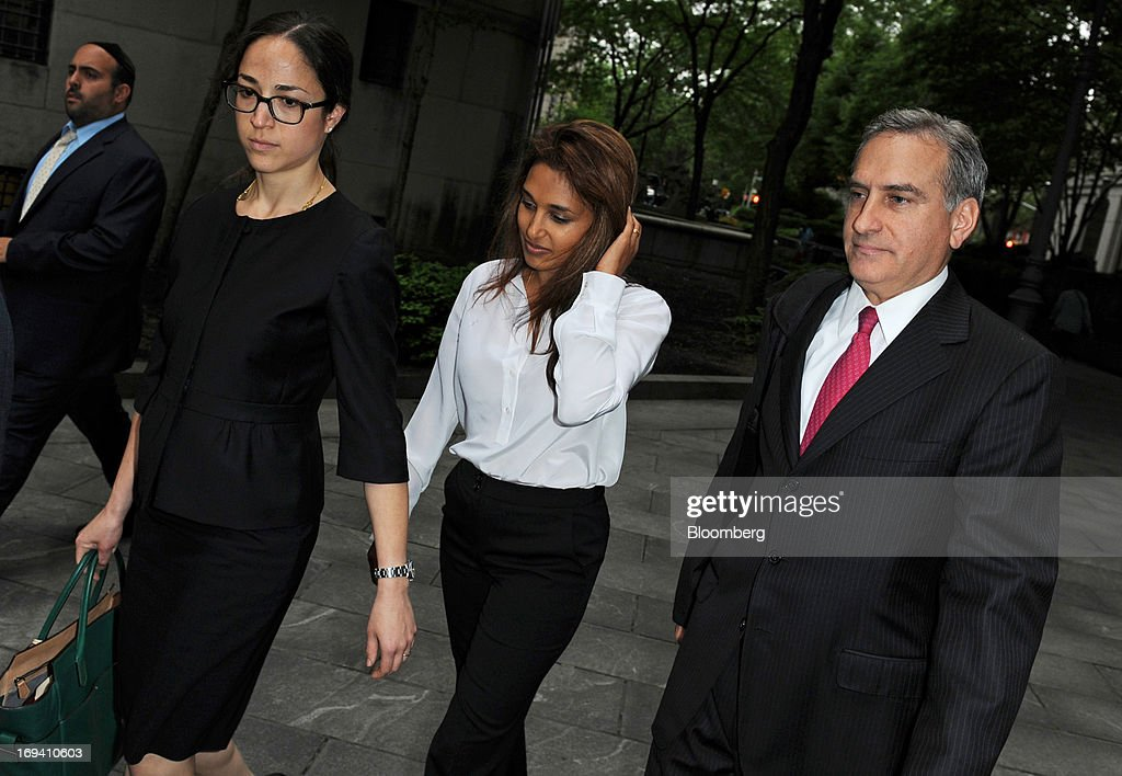 Rosemary Martoma, center, wife of Mathew Martoma, a former SAC Capital Advisors LP portfolio manager accused of insider trading, and attorney Richard Strassberg, right, arrive at federal court in New York, U.S., on Friday, May 24, 2013. Mathew Martoma will be allowed to get documents from the U.S. Securities and Exchange Commission in its civil suit against him, a judge ruled. Photographer: Peter Foley/Bloomberg via Getty Images