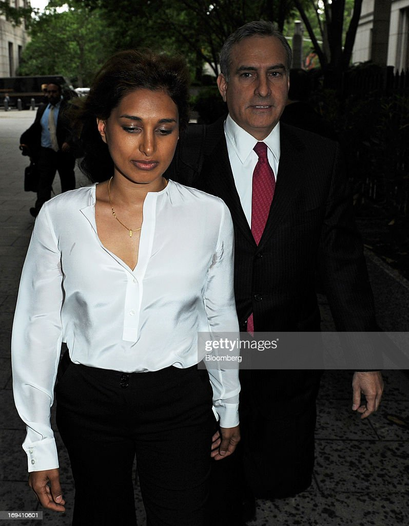 Rosemary Martoma, left, wife of Mathew Martoma, a former SAC Capital Advisors LP portfolio manager accused of insider trading, and attorney Richard Strassberg, right, arrive at federal court in New York, U.S., on Friday, May 24, 2013. Mathew Martoma will be allowed to get documents from the U.S. Securities and Exchange Commission in its civil suit against him, a judge ruled. Photographer: Peter Foley/Bloomberg via Getty Images