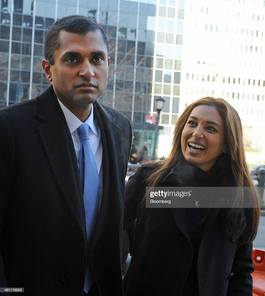 Rosemary Martoma, right, smiles at her husband Mathew Martoma, a former portfolio manager with SAC Capital Advisors LP, as they arrive at federal court in New York, U.S., on Tuesday, Jan. 7, 2014. Mathew Martoma, whose trial begins today, won rulings limiting the evidence prosecutors can use to try to prove he made $276 million for SAC based on inside information from two doctors supervising a clinical drug trial. Photographer: Louis Lanzano/Bloomberg via Getty Images
