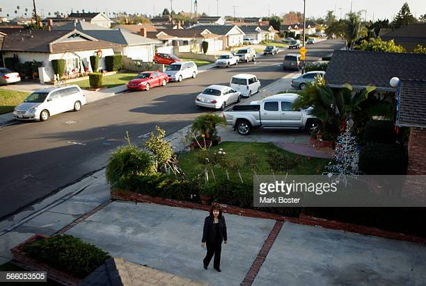 Rosemary Naval walks up her driveway on Panama Avenue in Carson However she and her husband Rudy are living a nightmare in the home that they hoped...