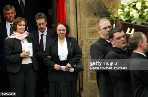Rosemary the wife of former Celtic Newcastle United and Scotland player Ronnie Simpson follows her husbands coffin out of St Ninians church in...