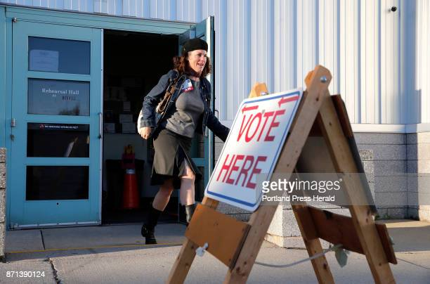 Rosemary Warnock a registered nurse at Maine Health exits the Merrill Auditorium voting station early on Tuesday Warnock said she was particularly...