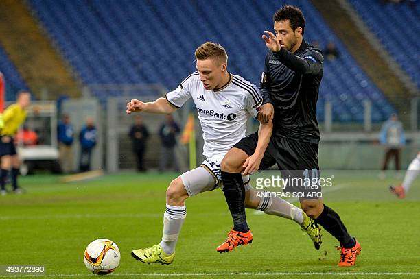 Rosenborg BK's defender from Norway Jonas Svensson fights for the ball with Lazio's midfielder from Brazil Felipe Anderson during UEFA Europa League...