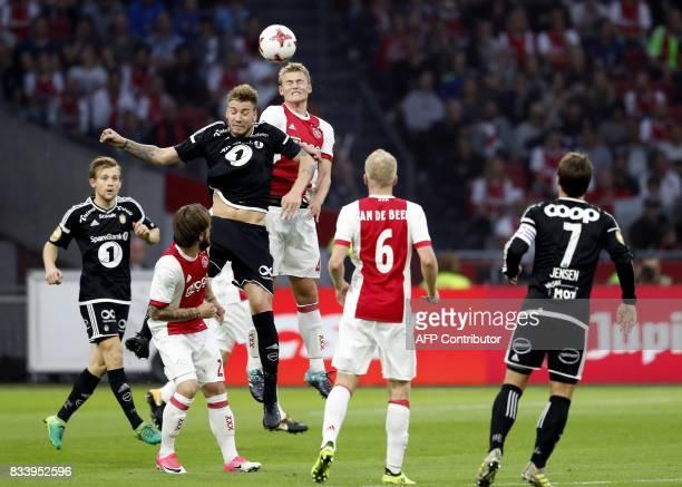 Rosenborg BK's Nicklas Bendtner vies with Ajax's Matthijs de Ligt during the UEFA Europa League playoff first leg soccer match between Rosenborg BK...