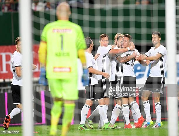 Rosenborg players celebrate a goal during the UEFA Europa League PlayOff first leg match FK Austria Wien vs Rosenborg Trondheim on August 18 2016 /...