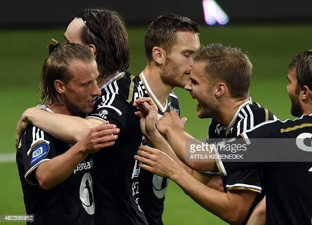 Rosenborg's Danish forward Tobias Mikkelsen celebrates with teammates after scoring the 13 during the UEFA Europa League third qualifying round...