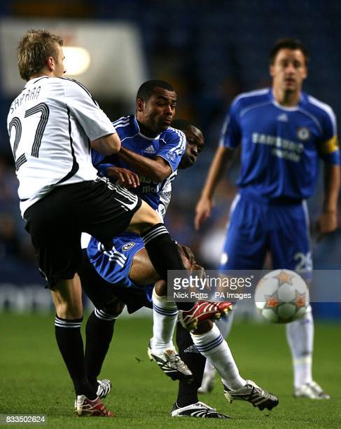 Rosenborg's Marek Sapara and Yssouf Kone combine to deny Chelsea's Ashley Cole