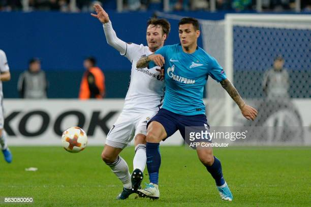 Rosenborg's midfielder from Denmark Mike Jensen and Zenit St Petersburg's midfielder from Argentina Leandro Paredes vie for the ball during the UEFA...