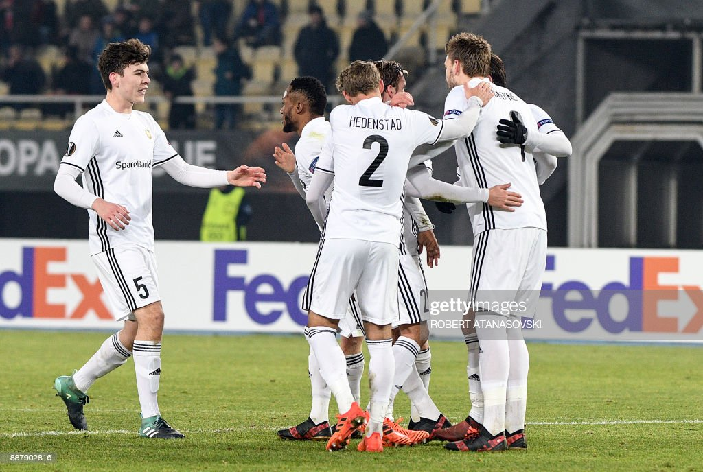 Rosenborg's players celebrate after scoring a goal during the UEFA Europa League group L football match between FK Vardar and Rosenborg BK at the Filip II Arena in Skopje on December 7, 2017. / AFP PHOTO / Robert ATANASOVSKI