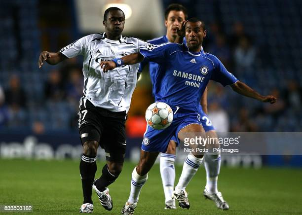 Rosenborg's Yssouf Kone and Chelsea's Ashley Cole battle for the ball