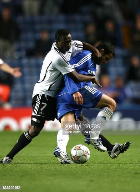 Rosenborg's Yssouf Kone and Chelsea's Juliano Belletti battle for the ball