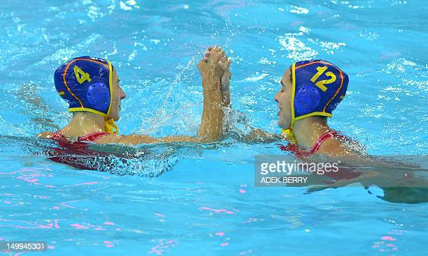 Roser Tarrago Aymerich and Laura Ventosa Lopez of Spain react after scoring during the women's water polo semifinal match between Hungary and Spain...