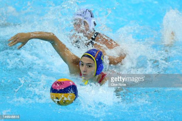 Roser Tarrago Aymerich of Spain competes for the ball in the Women's Water Polo semifinal match between Spain and Hungary at the Water Polo Arena on...