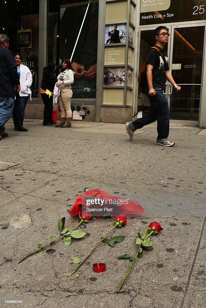 Roses are left next to where the body of Michael Jones, a youth soccer coach, was found early Sunday morning outside the Levi's store on October 8, 2012 in New York City. Emergency responders found the 25-year-old native of Liverpool, England, laying in a pool of blood with numerous stab wounds to his neck and torso and was soon pronounced dead. Jones was a part-time coach with the New York Red Bulls' youth soccer team and lived in Westchester County. Reportedly, Jones can be seen in surveillance video arguing with a man before the attack. While police are looking for the suspect, no arrests have been made.