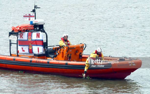 Roses are placed into the Thames for each person who died in the disaster from a similar lifeboat in the Thames New RNLI lifeboat in memory of the...