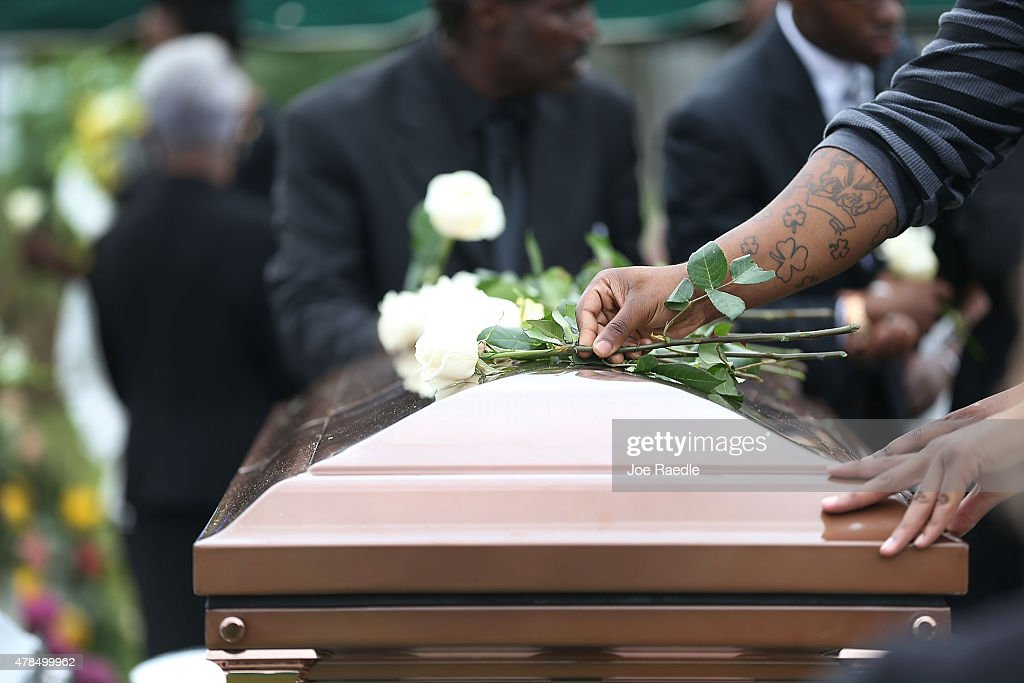 Roses are placed on the casket of Ethel Lance who was one of nine victims of a mass shooting at the Emanuel African Methodist Episcopal Church before...