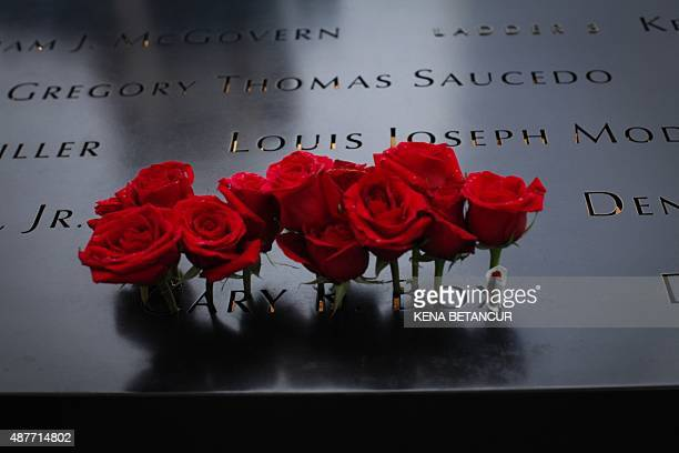 Roses are seen placed on the 9/11 memorial before the ceremony to commemorate the 14th Anniversary of the terrorist attacks on September 11 2015 in...