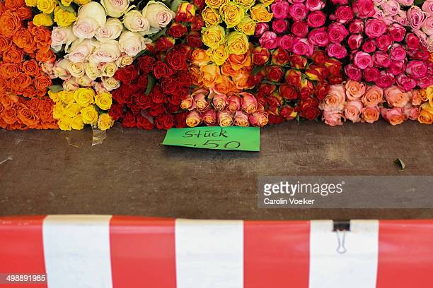 Roses at a market stand