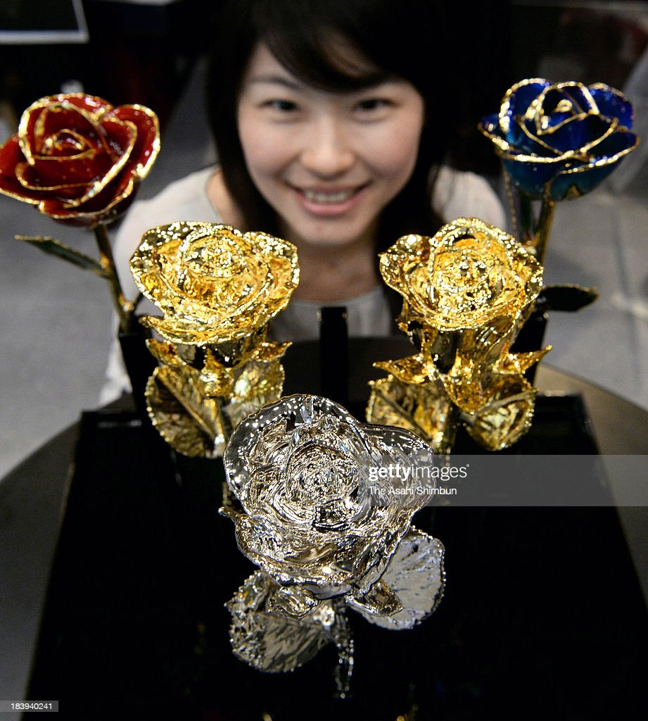 Roses covered with gold and platinium are shown at the International Flower Expo Tokyo at Makuhari Messe on October 9, 2013 in Chiba, Japan. The roses that have been specially preserved with petals covered in gold and platinum, cost in the region of 30,000 Japanese yen (approximately 308 U.S. Dollars) apiece.