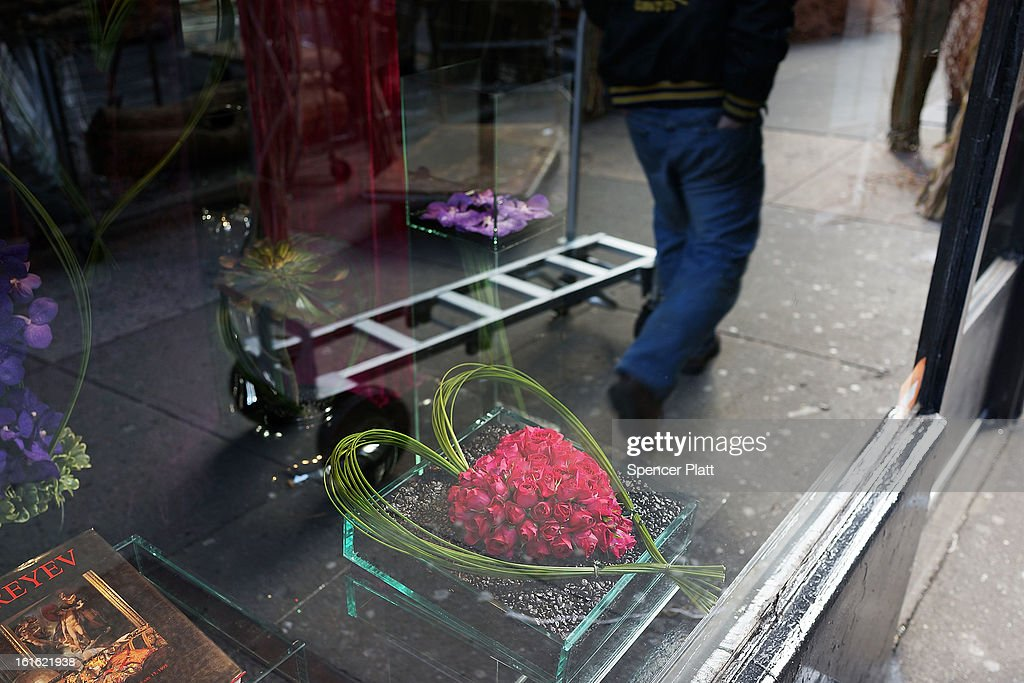Roses in a heart are viewed in the window of a flower store in the floral district on February 13, 2013 in New York City. With Valentines Day tomorrow, the district is experiencing a rush of floral buyers and sellers to service customers on the national day of romance. Along with Mother's Day, Valentine's Day is one of the busiest days of the year for florists and flower growers.