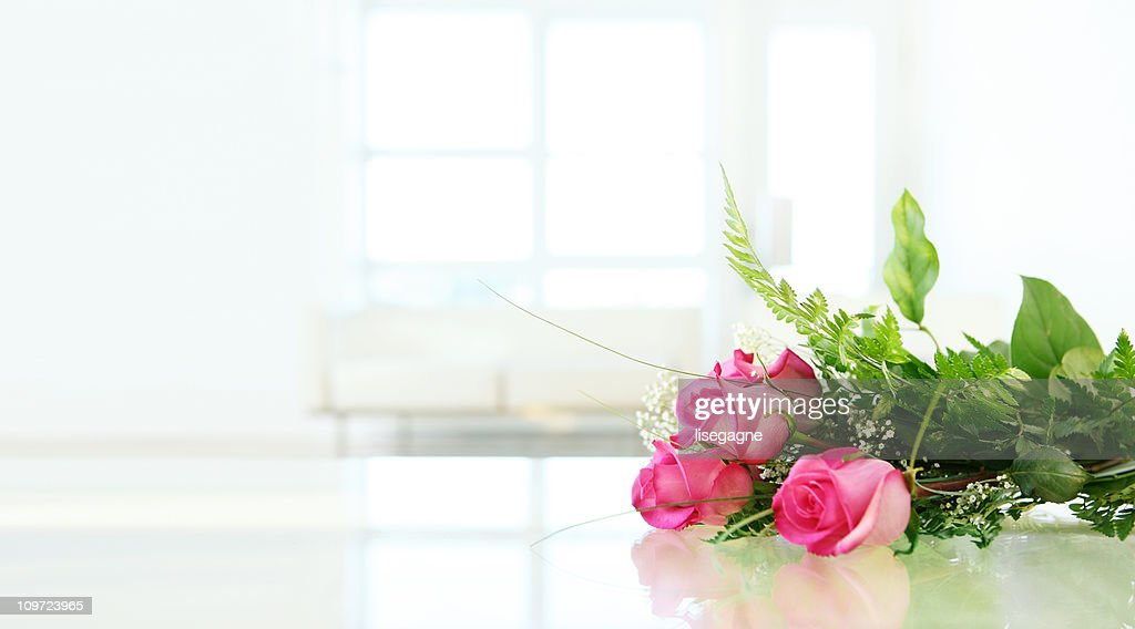 Roses on Glass Table : Stock Photo