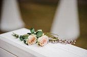 Roses on the wedding box. Ceremony. Wedding decorations.