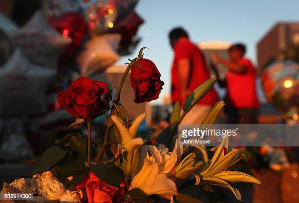 Roses stand at a makeshift memorial for Muhammad Ali outside the Muhammad Ali Center on June 8 2016 in Louisville Kentucky A funeral procession and...