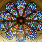 Rosette window in the sanctuary above the organ in Braunschweig Cathedral made of a colourful mosaic of small pieces of glass and glass panes