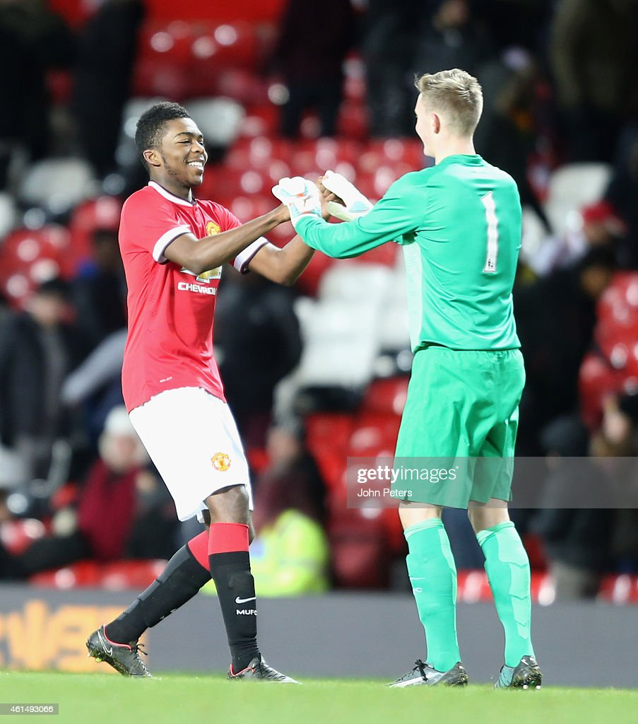 Ro-Shaun Williams and Dean Henderson of Manchester United U18s celebrate after the FA Youth Cup Fourth Round match between Manchester United U18s and Hull City U18s at Old Trafford on January 13, 2015 in Manchester, England.