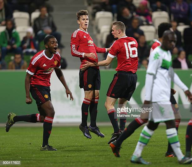RoShaun Williams Ethan Hamilton and Callum Gribbin of Manchester United U19s celebrate Axel Tuanzebe scoring their first goal during the UEFA Youth...
