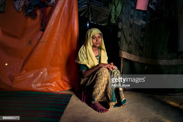 COX'S BAZAR BANGLADESH DECEMBER 01 Roshida Begum poses for a photo on December 1 2017 in Cox's Bazar Bangladesh She fled to Bangladesh shortly after...