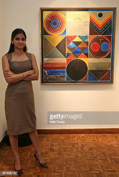 Roshini Vadehra of Vadehra Art gallery poses with one of the Raza paintings from her collection in New Delhi on February 24 2010 The gallery is...