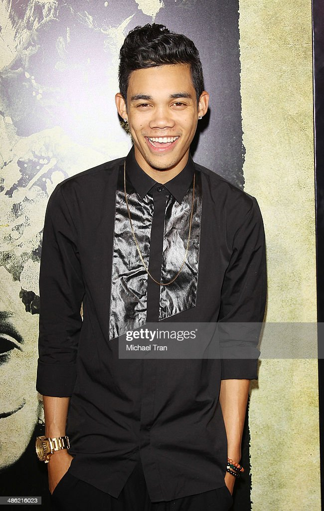 Roshon Fegan arrives at the Los Angeles Premiere of 'The Quiet Ones' held at The Theatre at Ace Hotel on April 22 2014 in Los Angeles California