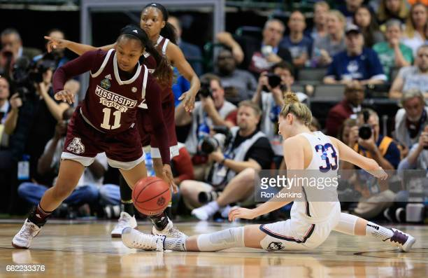 Roshunda Johnson of the Mississippi State Lady Bulldogs drives against Katie Lou Samuelson of the Connecticut Huskies in the first half during the...