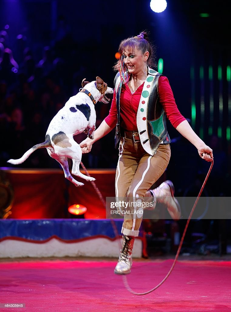 Rosi Hochegger a dog trainer, performs during the Award Gala evening of the 38th International Circus Festival of Monte Carlo in Monaco on January 21, 2014. AFP PHOTO POOL / ERIC GAILLARD