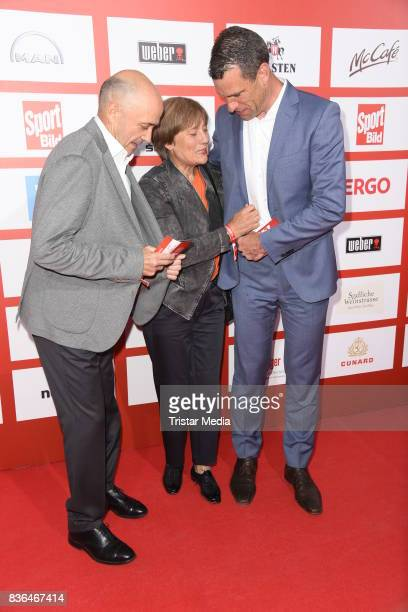 Rosi Mittermaier her husband Christian Neureuther and Michael Ilgner attend the Sport Bild Award on August 21 2017 in Hamburg Germany