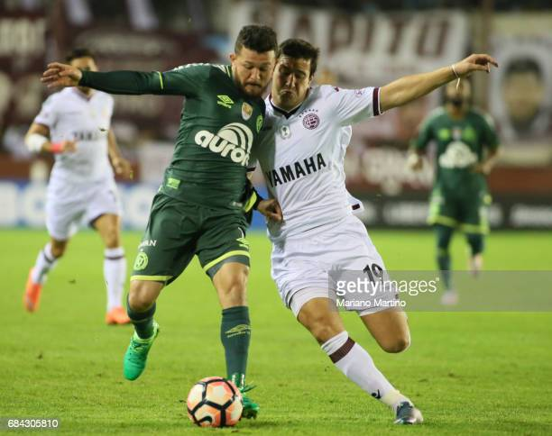 Rosicley Pereira of Chapecoense and Nicolas Aguirre of Lanus fight for the ball during a group stage match between Lanus and Chapecoense as part of...