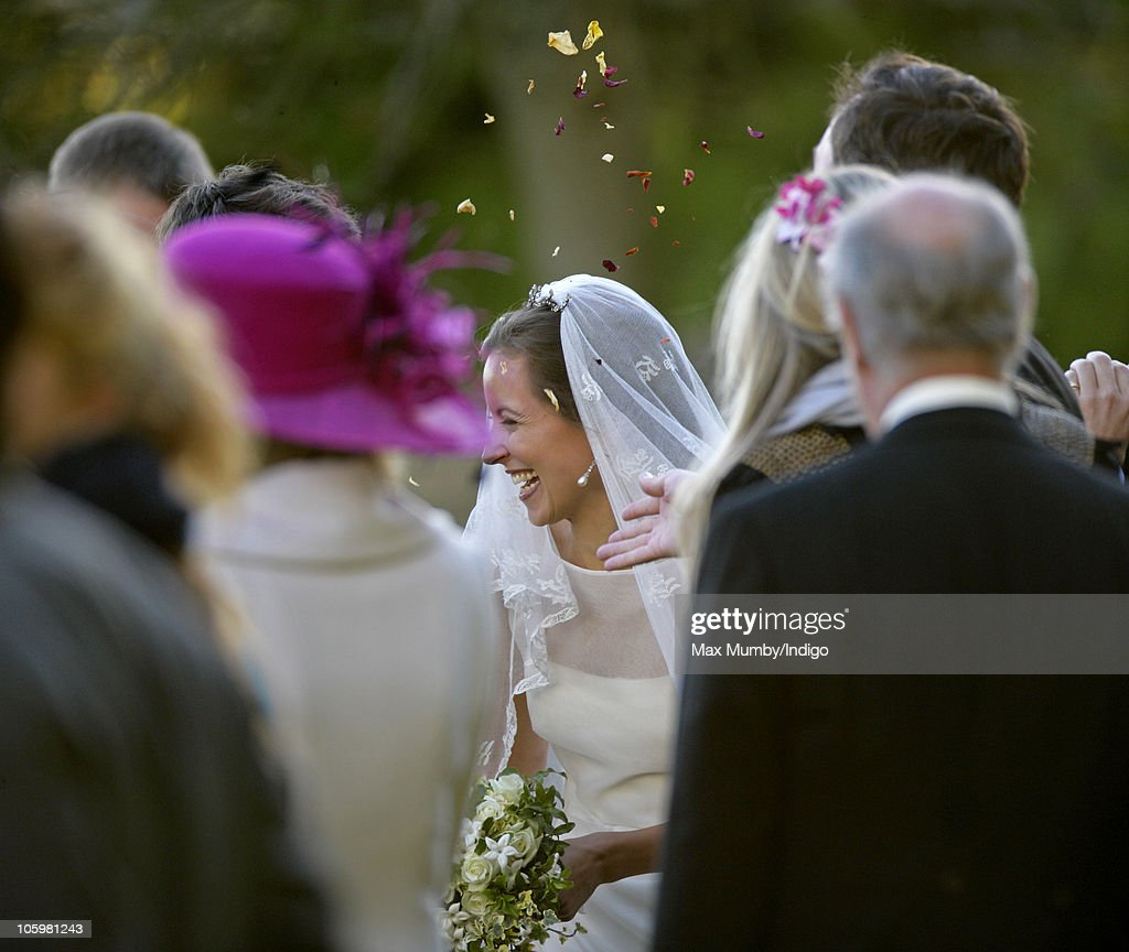 Rosie Bradford is showered in confetti as she leaves the Church of St. Peter and St. Paul on October 23, 2010 in Northleach near Cheltenham, England.