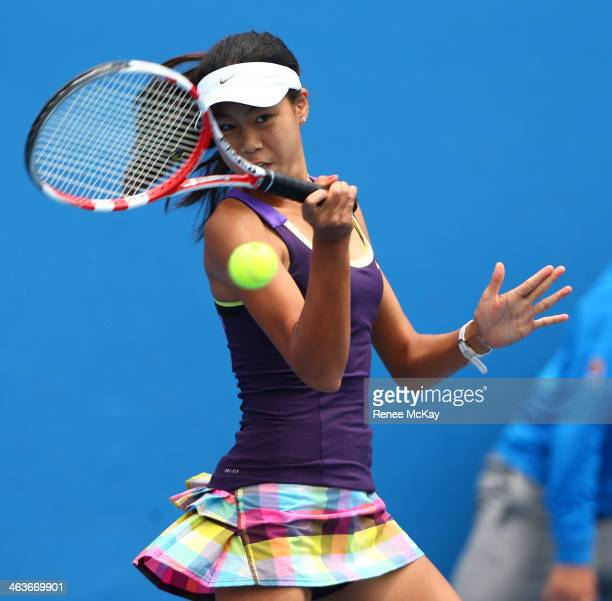 Rosie Cheng of New Zealand plays a forehand in her first round junior girls' match against Fanny Stollar of Hungary during the 2014 Australian Open...