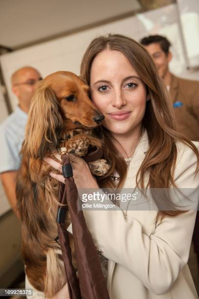 Rosie Fortescue with her Dachshund Noodle host the petspyjamascom fashion industry pet party on June 4 2013 in London England