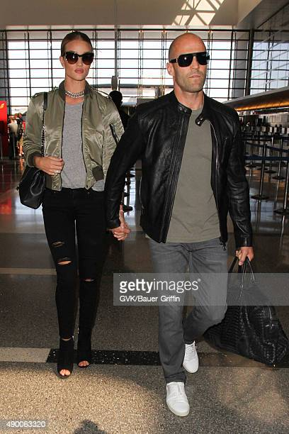 Rosie Huntington Whiteley and Jason Statham are seen at LAX on September 25 2015 in Los Angeles California